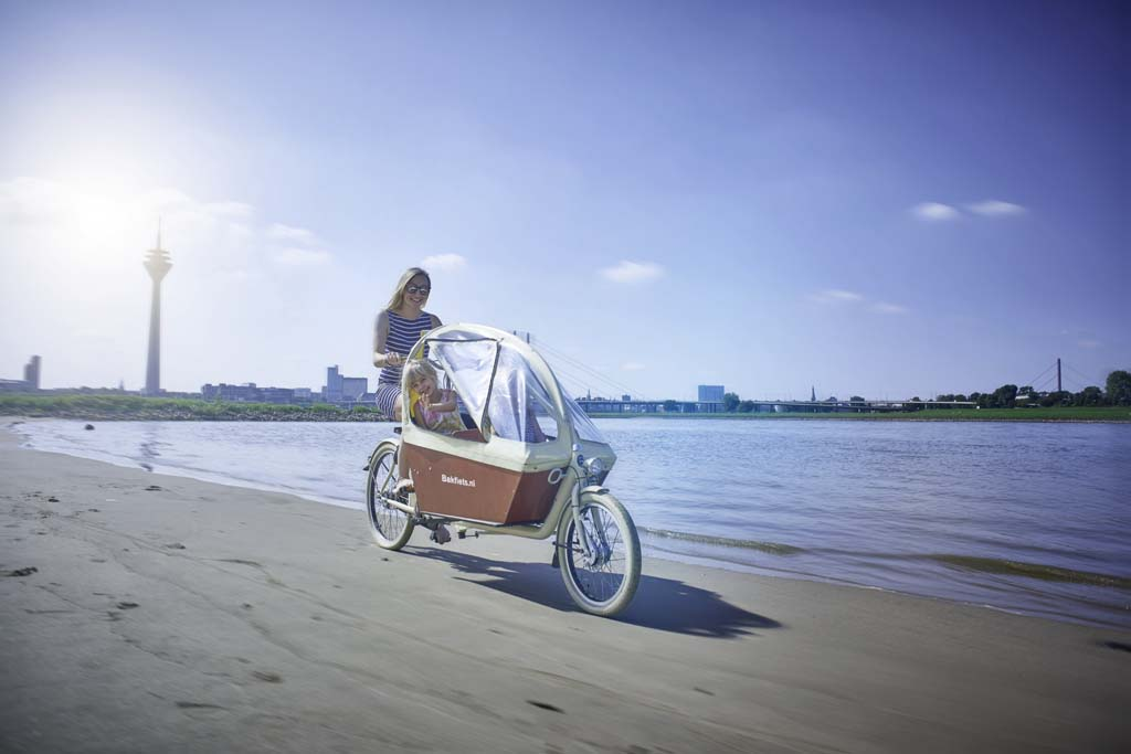 Electric cargo bike on the beach - Amsterdam Bicycle Company